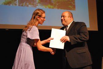 Angela Constantine (Westford) receives a Friends of Cameron Senior Center Scholarship from Principal Matthew Ricard. COURTESY PHOTO